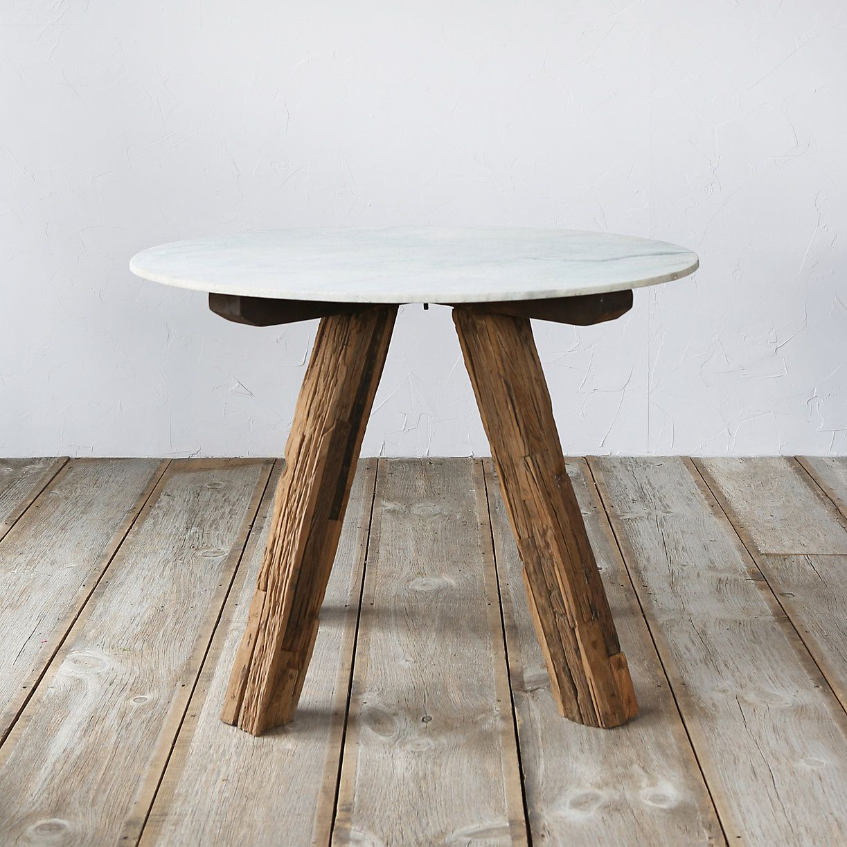A Clean, Marble Top Pairs With Rustic Legs Of Recycled Mango Wood To Form  This