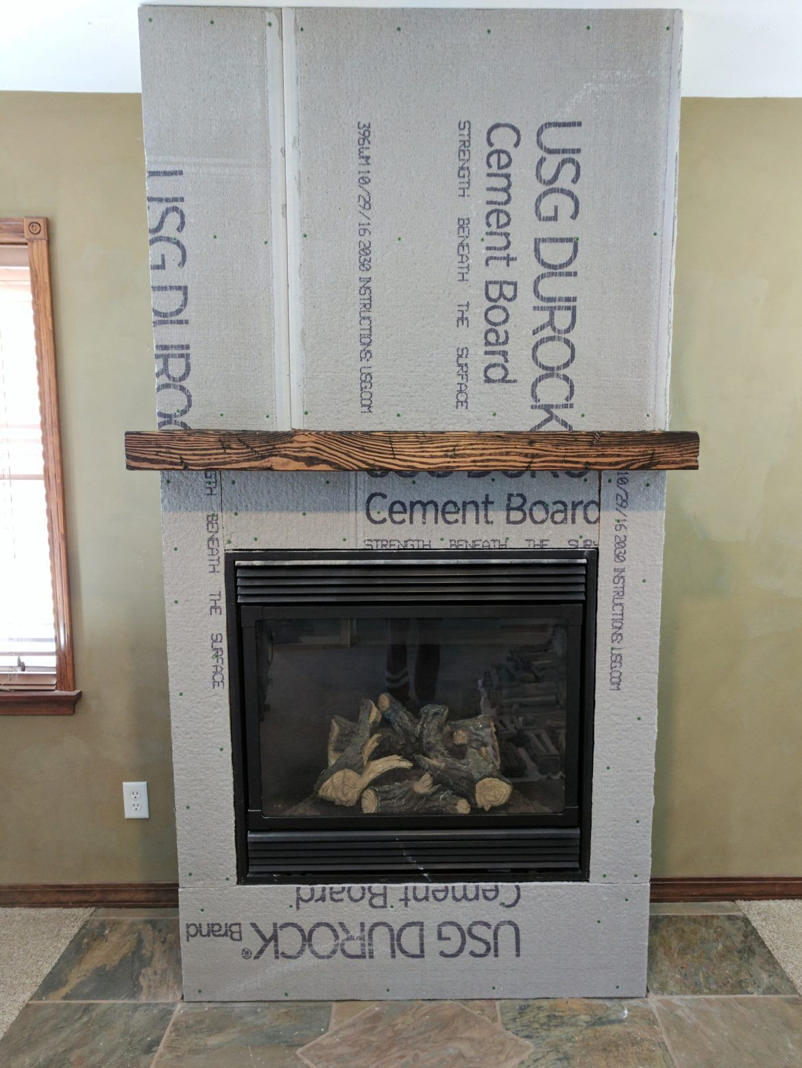Reclaimed barn wood fireplace makeover! Fireplace