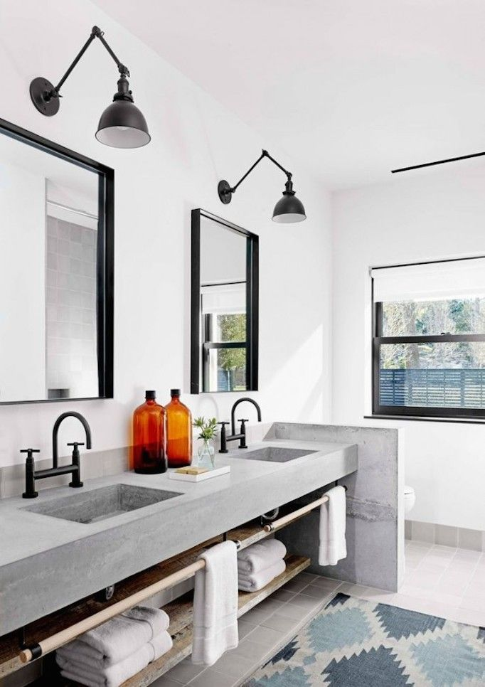 Black Faucets + Swing Arm Lighting In The Bath