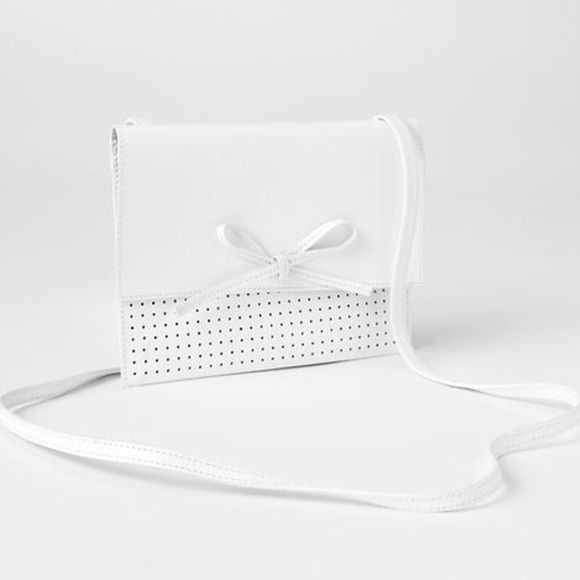❗️️️️️LAST CHANCE! GAP White Leather Bow Bag! ❗️️️️️LAST CHANCE! SOLD out in stores! 30% off bundles deal ends today! GAP White 100% Leather Bow Small Crossbody bag! NWT retails $55. 100% leather all details in 4th pic. Tags not attached to this bag but is new bought straight from GAP. NWT perfect condition. I consider all strong offers so feel free to make an offer & it's yours! Snatch it up before someone else does! ASAP shipping! Extra 30% off on bundles! Suggested User  GAP Bags