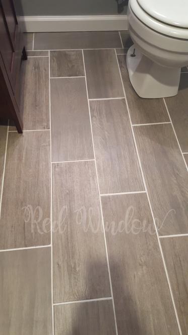 Wood Look Tile Flooring In Our Half Bathroom Bathroom Floor Tiles Bathrooms Remodel Tile Bathroom