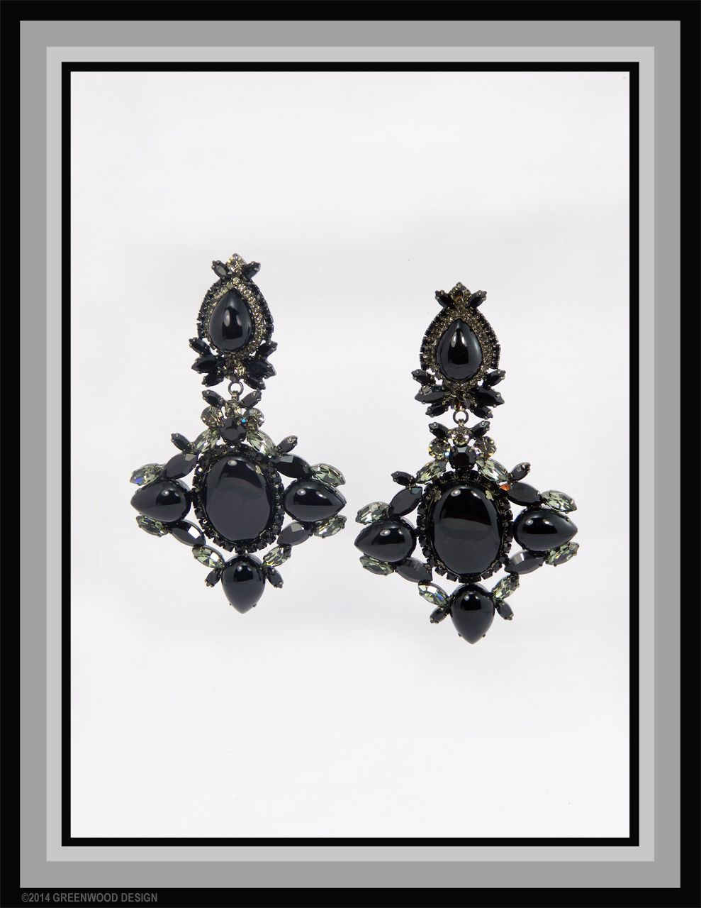 Confident and statement-making chandelier earrings feature pure polished Onyx cabochons surrounded by Swarovski stonesin Crystal, Black Diamond and Jet - Made by Bryan Greenwood of Crystal Countess / Jewellery by Greenwood Design