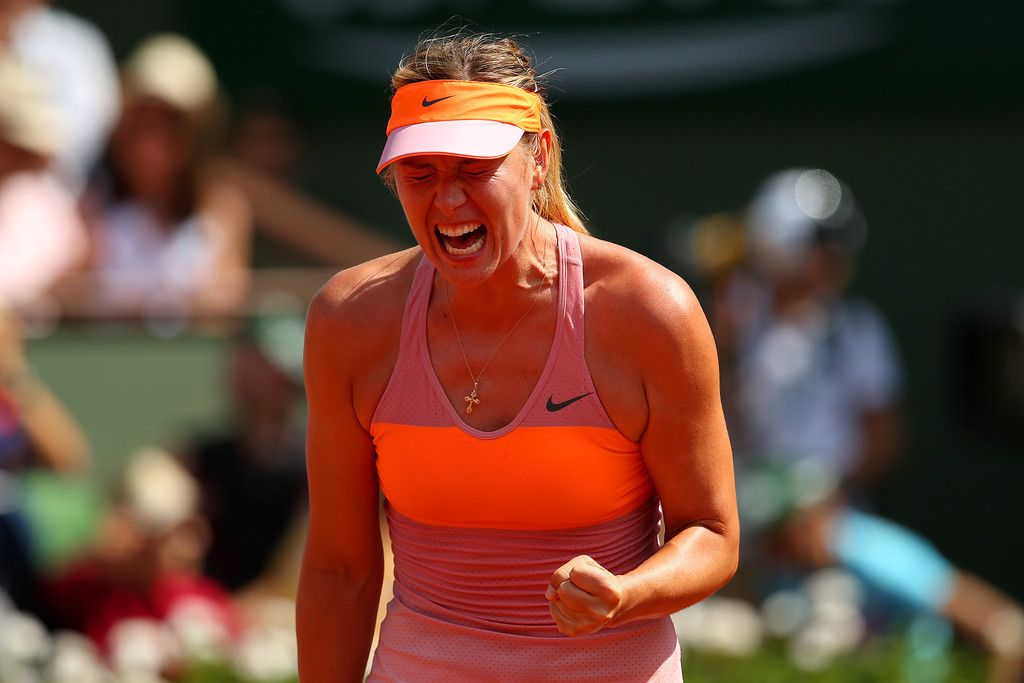Maria Sharapova Photos: 2014 French Open - Day Fourteen. Maria Sharapova of Russia celebrates a point during her women's singles final match against Simona Halep of Romania on day fourteen of the French Open at Roland Garros on June 7, 2014 in Paris, France.