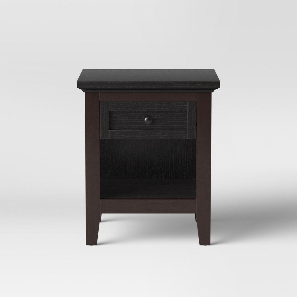 This rectangular Carson End Table from Threshold comes equipped with a nicely sized drawer to give you the perfect spot to keep remote controls coasters and other small items out of sight while a sturdy bottom shelf provides storage space for books and magazines. Place this elegant piece of furniture next to your sofa for a perfect touch of style and function. Color: Espresso Brown.. Carson End Table Espresso Brown - Thresho