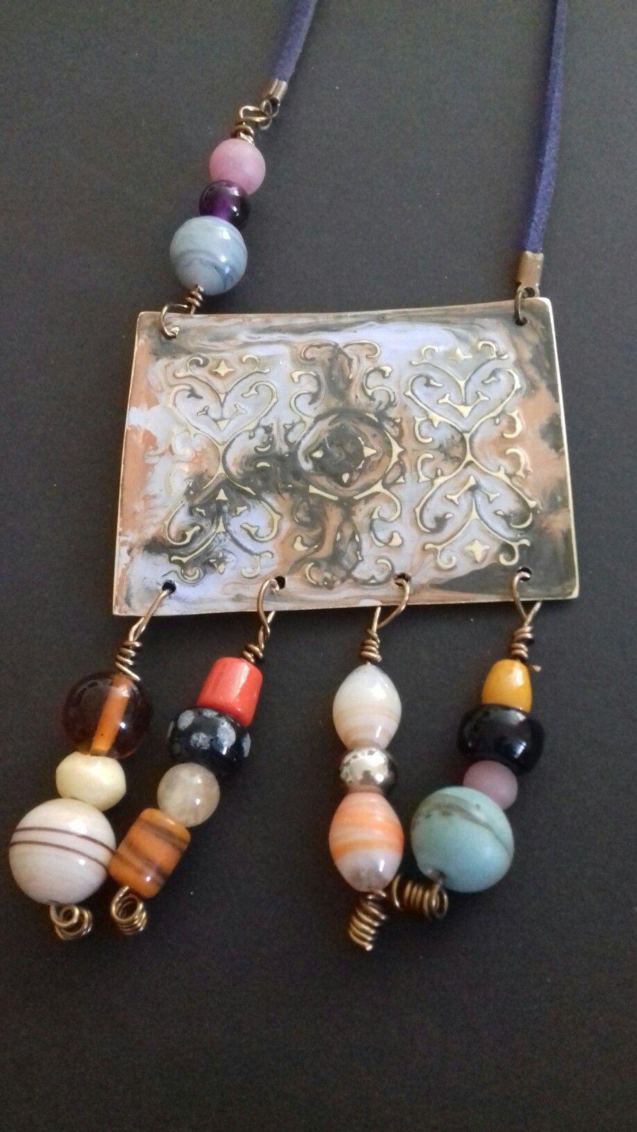 collana in ottone inciso e patinato con pietre dure di vari tipi e cordone in pelle scamosciata blu