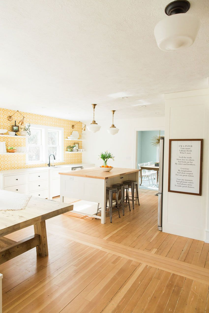 A Bright Kitchen With The Family Motto Hanging Proudly Tour