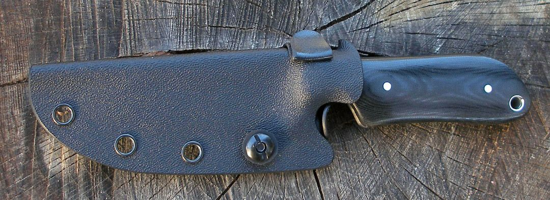 Kydex sheath with thumb release