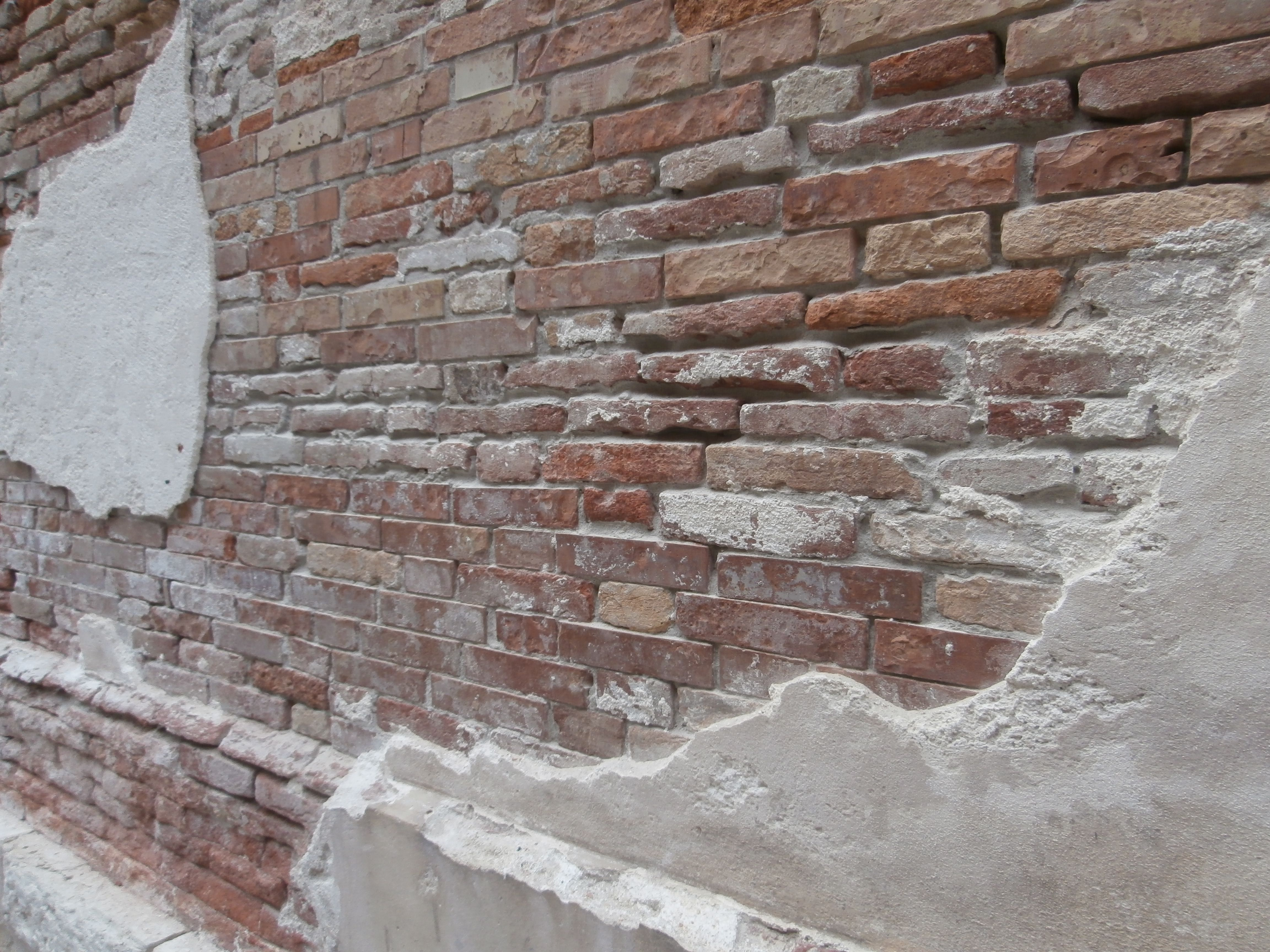 Venetian chipped plaster brick wall italy pinterest for How to clean smoke damage from painted walls