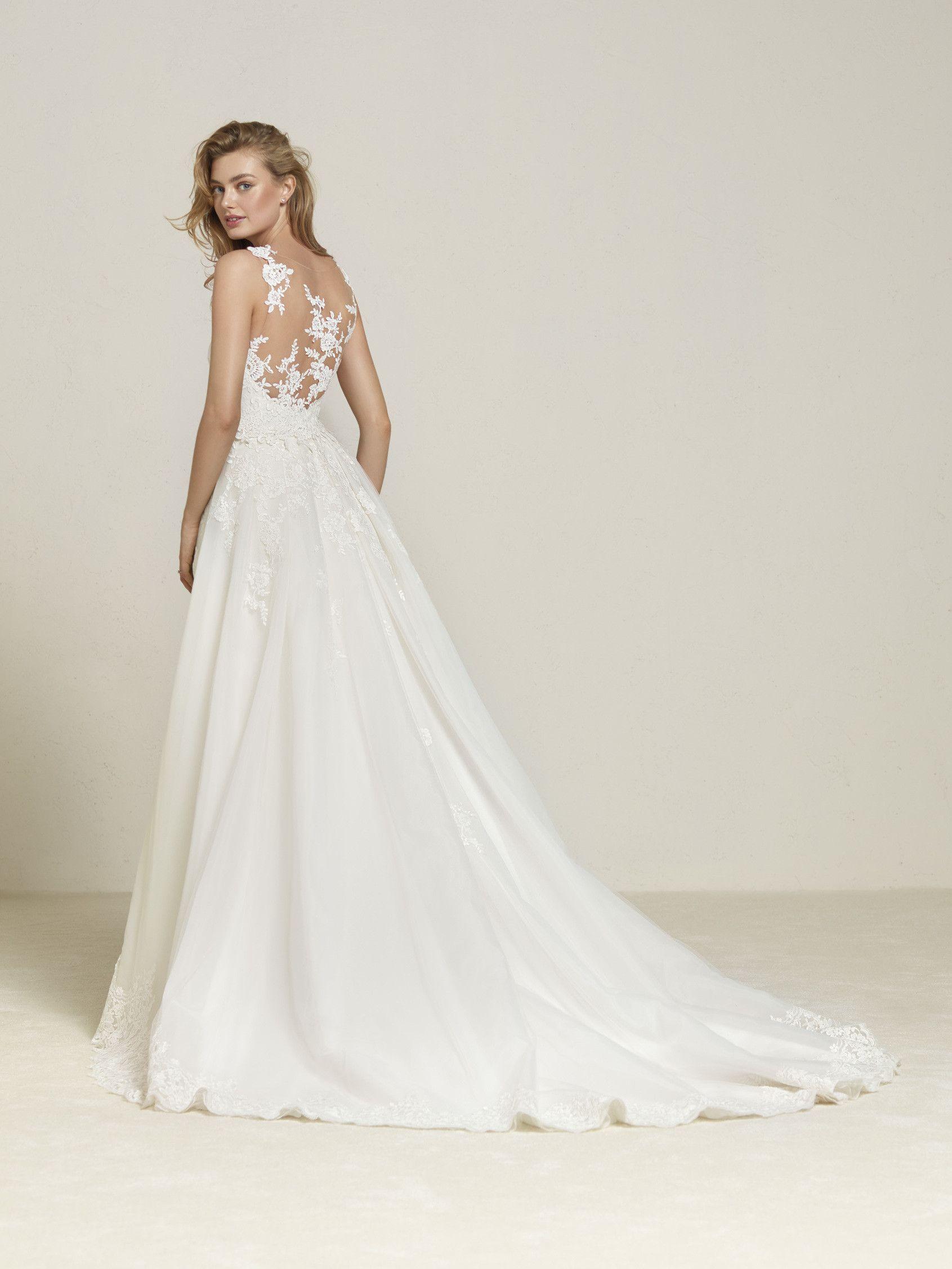 b23df26411 Vestido de novia con sobrefalda extraible
