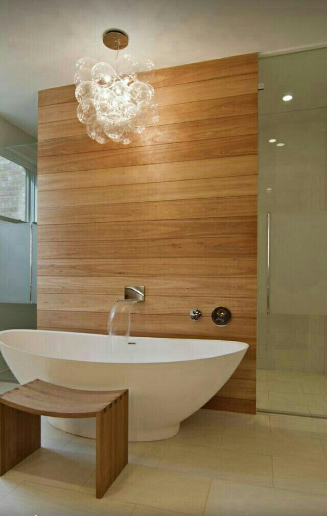 Modern luxurious bathroo with beautiful freestanding bathtub with ...