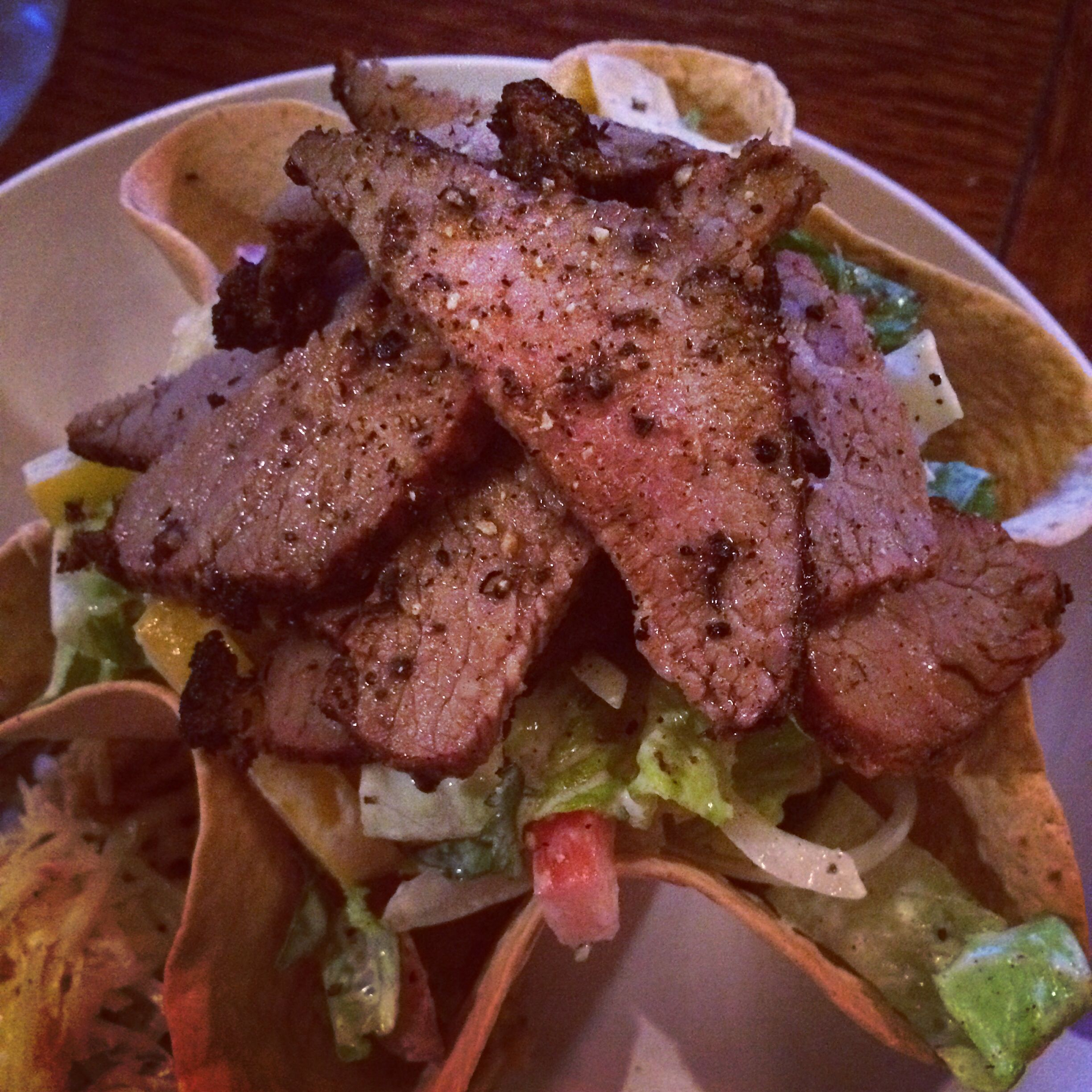 Steak Tostada with a Cilantro and Lime Crema dressing