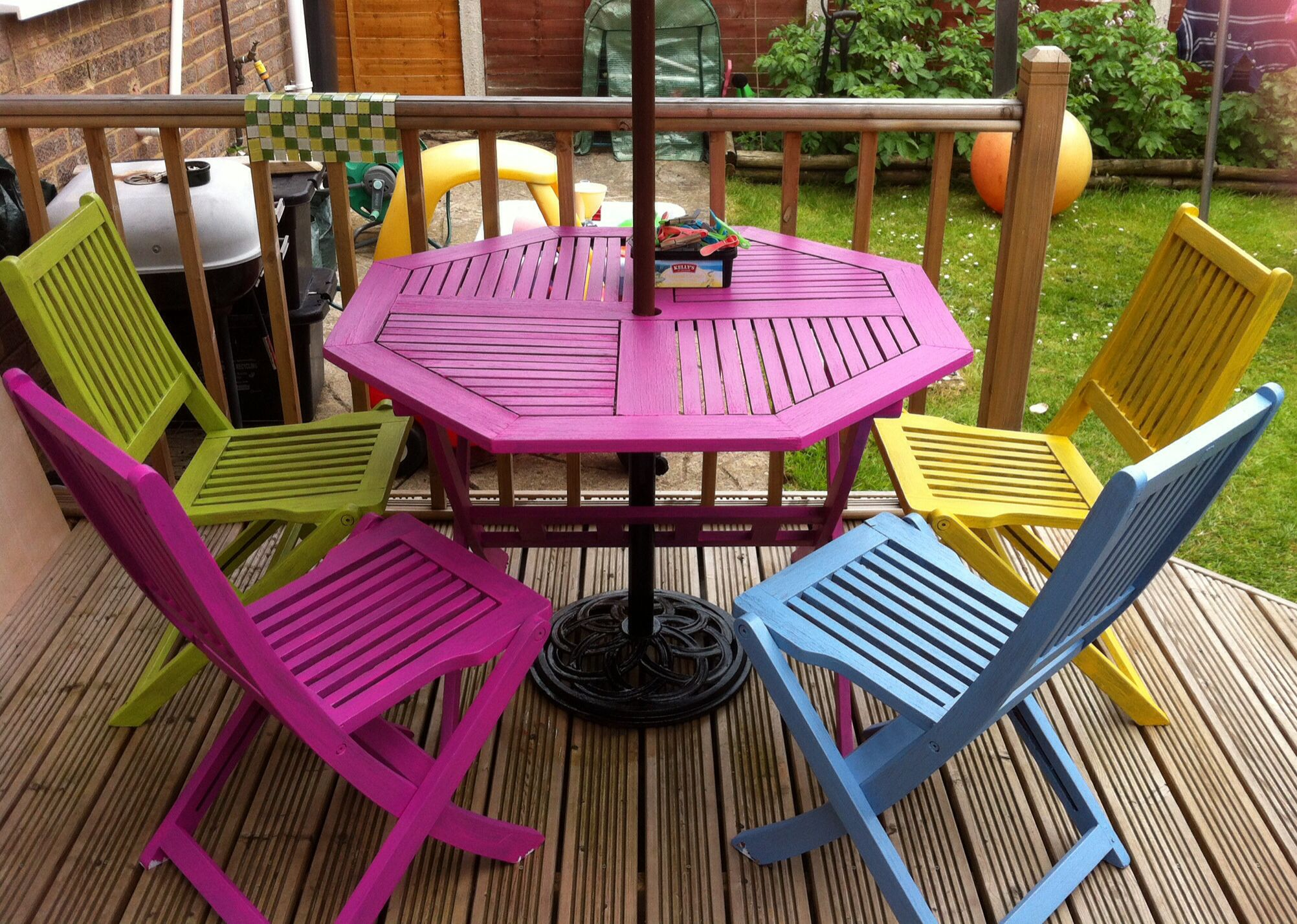 Bright painted garden furniture adds a bit of colour to the