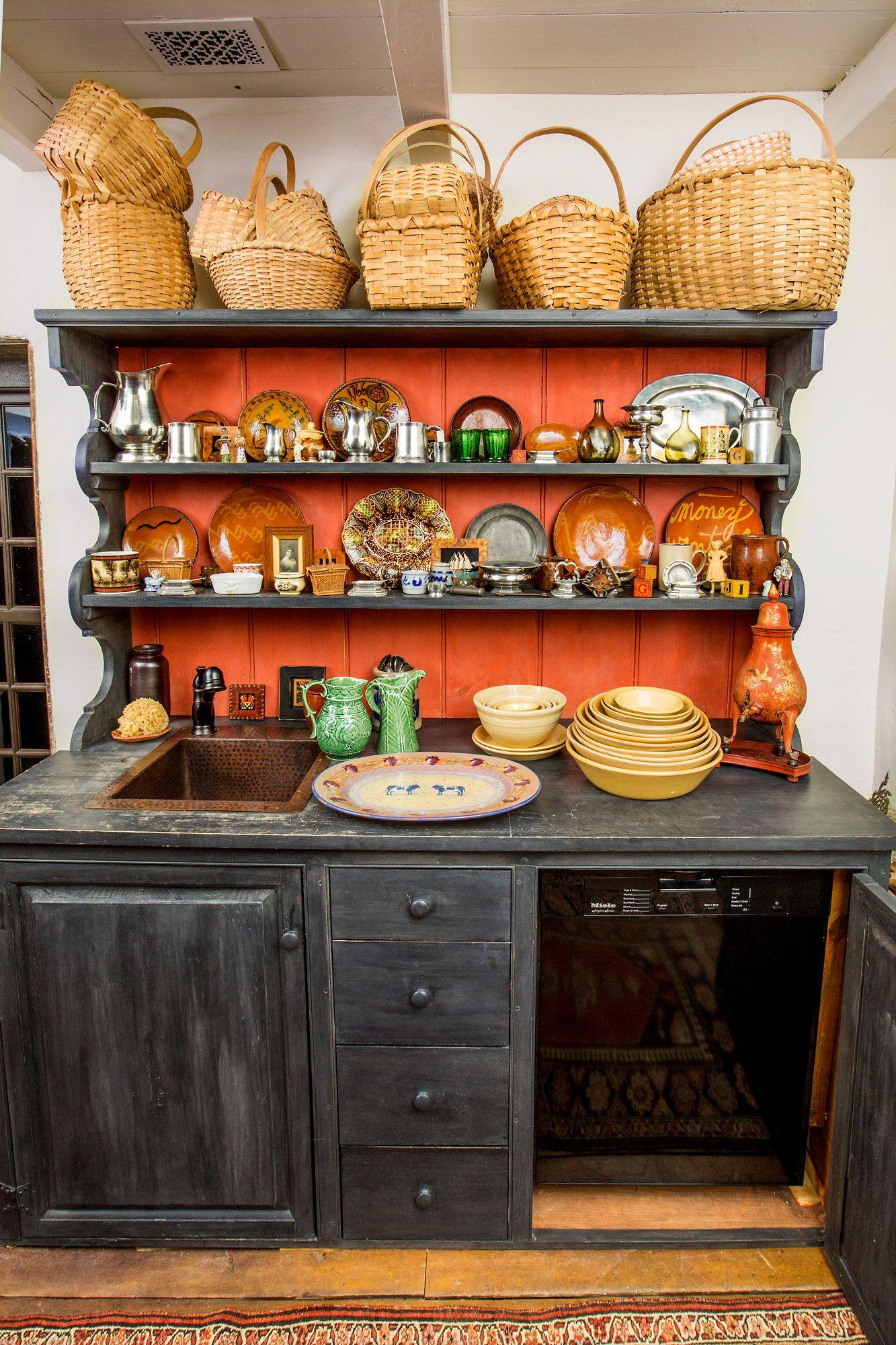 A periodappropriate cupboard in the stone house hides a