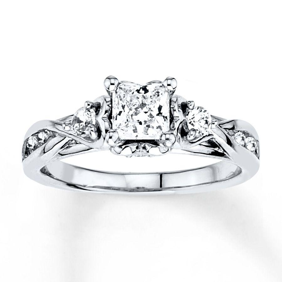 A Stunning Princesscut Diamond Is Nestled Inside A Setting Of Four Hearts  In… Amazing Engagement Ringsprincess