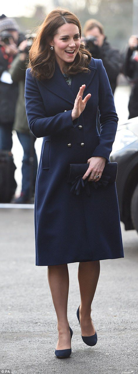She looked in cheerful form as she got stuck into royal duties again after the Christmas b...