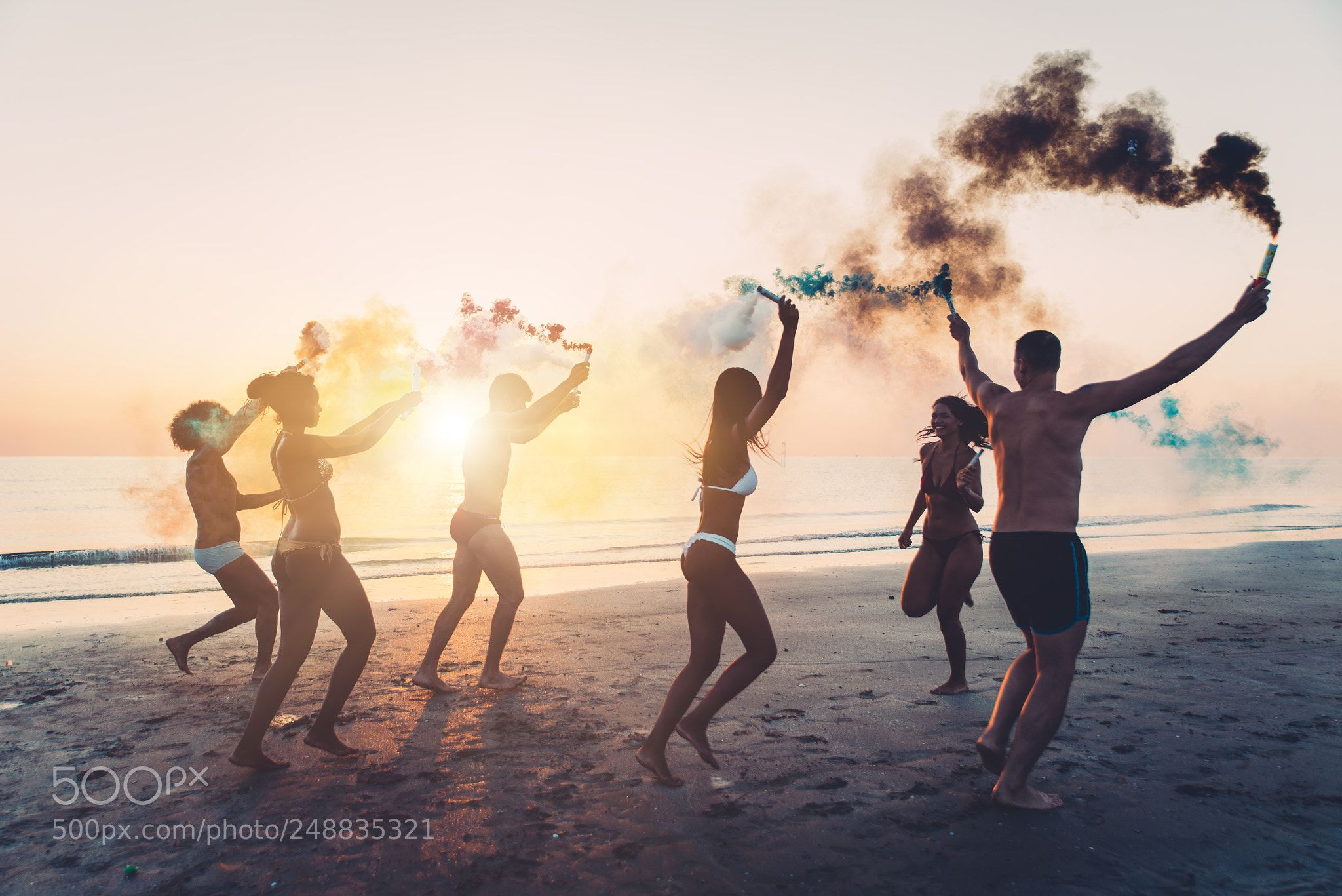 Group Of Friends Having Fun Running On The Beach With Smoke Bomb Group Of Friends Beach Friends Running On The Beach