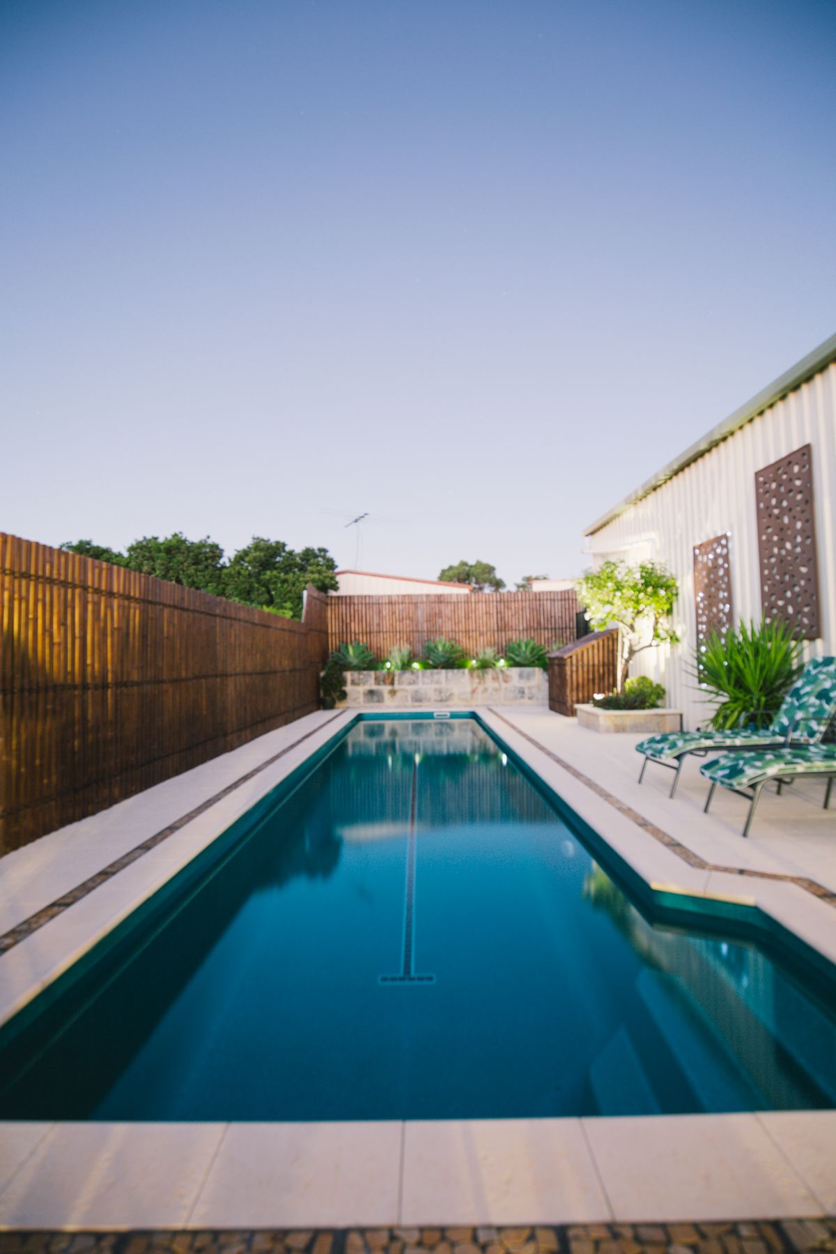 Lap Pools Offer The Best Of Both Worlds Leisure And Fitness This Backyard Lap Pool Is Perfect For A Slim Lot That Doesn T H Pool Lap Pools Backyard Spa Pool