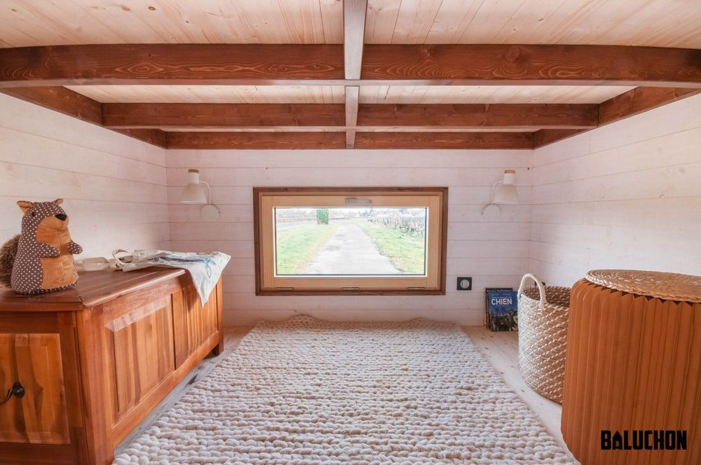 Compact tiny house has extra room for storage and guests