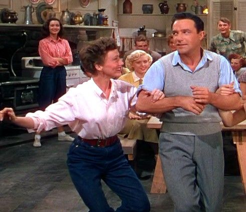 Gene Kelly and second wife, Jeanne Coyne. She was his assistant and often made cameos in his movies.