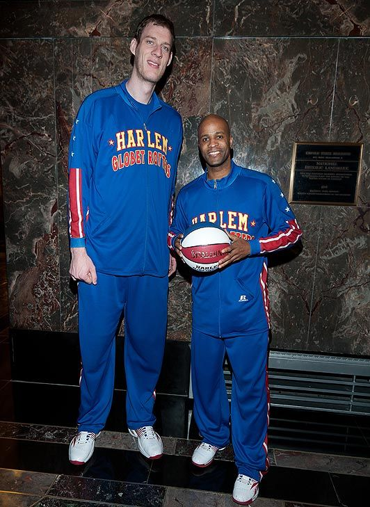 "7'8"" Paul Sturgess with his 6' 3"" Globetrotter team mate Herbert Lang."
