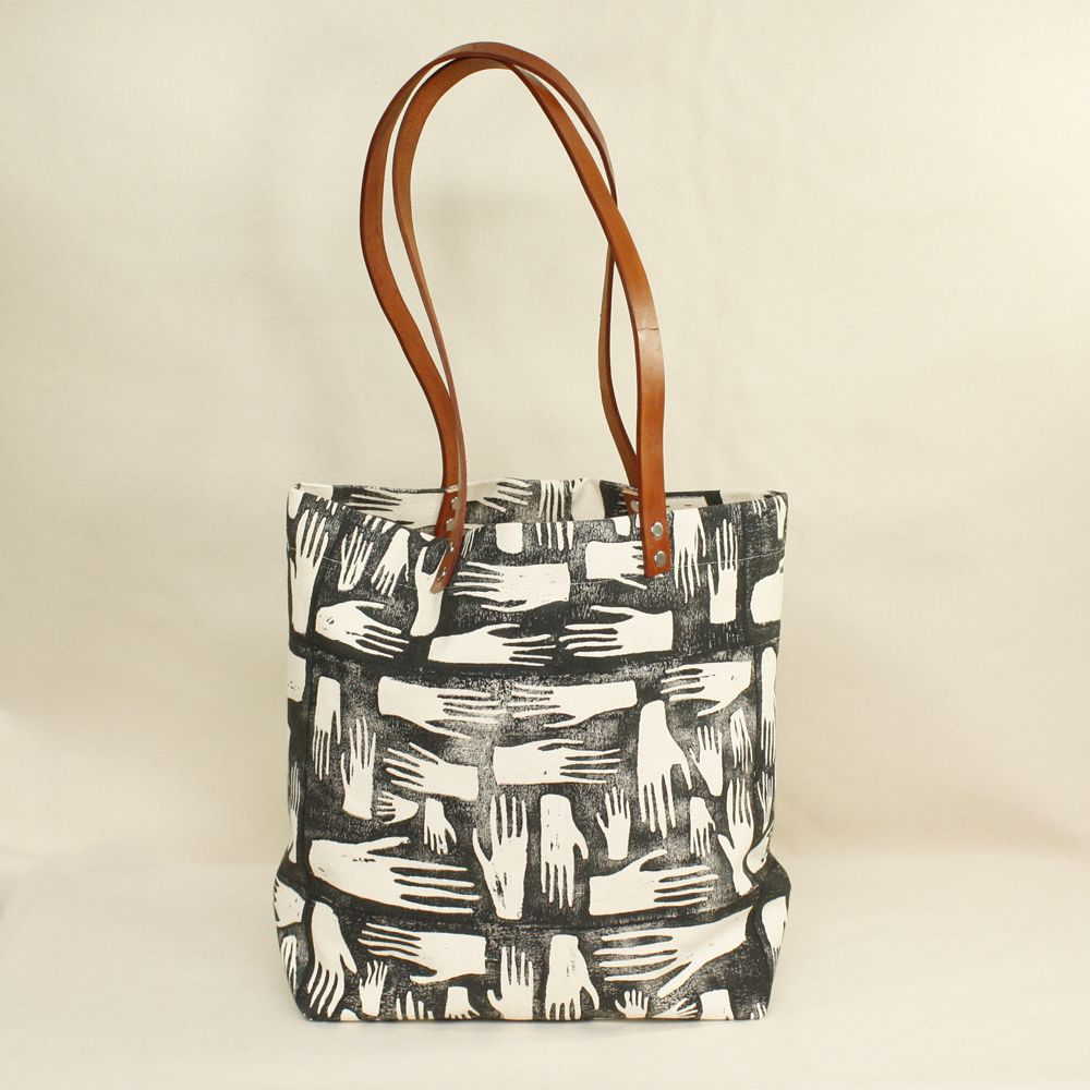 A super sturdy large natural canvas tote bag with a block