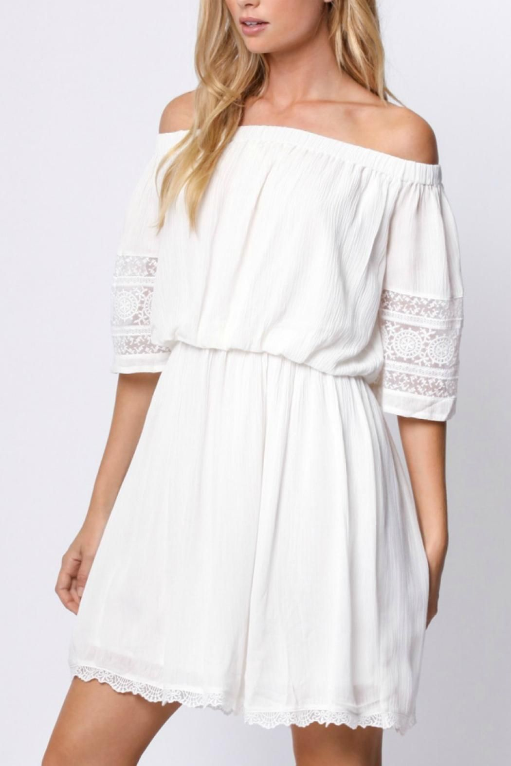 8eb116662b The off the shoulder look is totally in this year. This off the shoulder  white