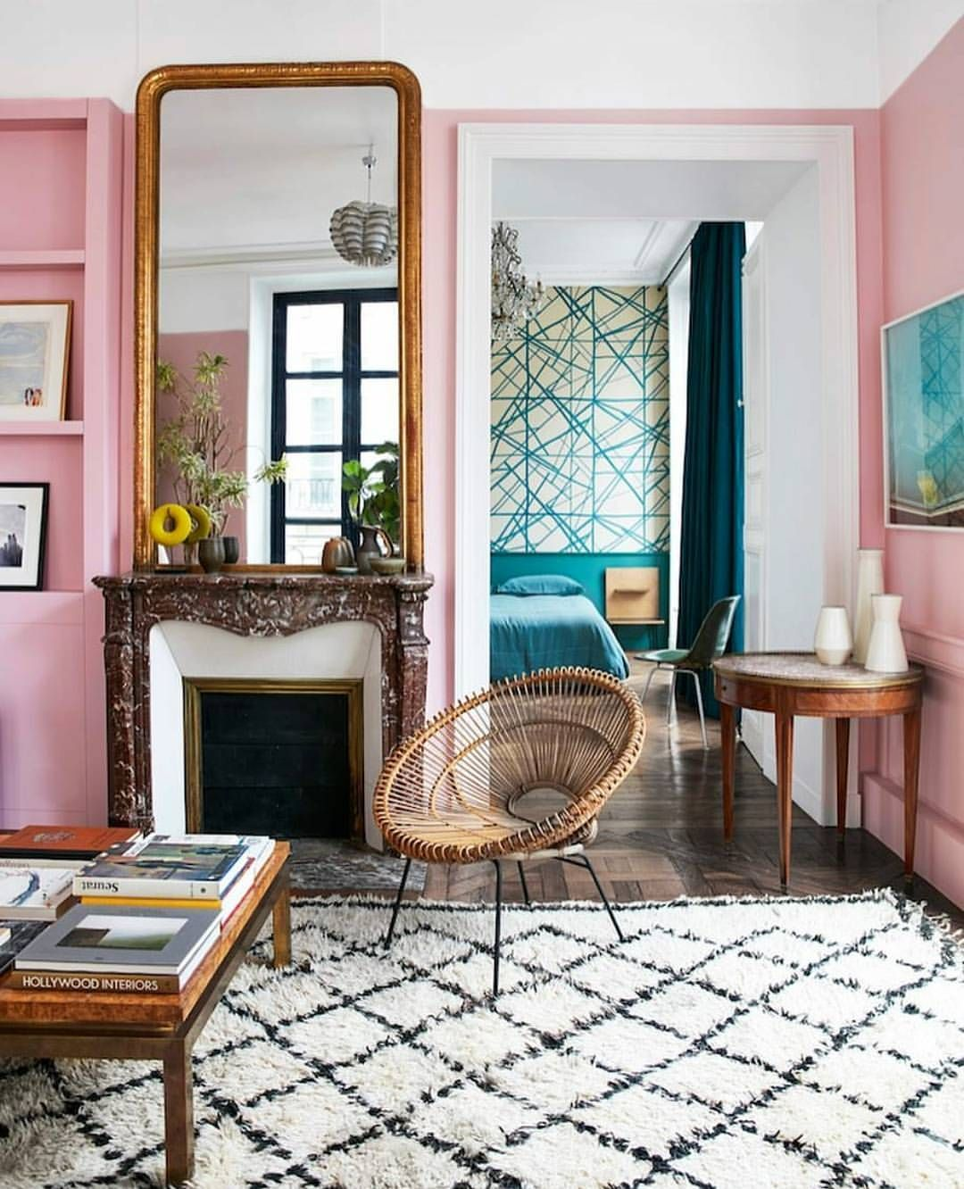 This 1718 parisian apartment has been beautifully modernized with pink walls geometric patterns and flea market finds new meets old in a very fun way