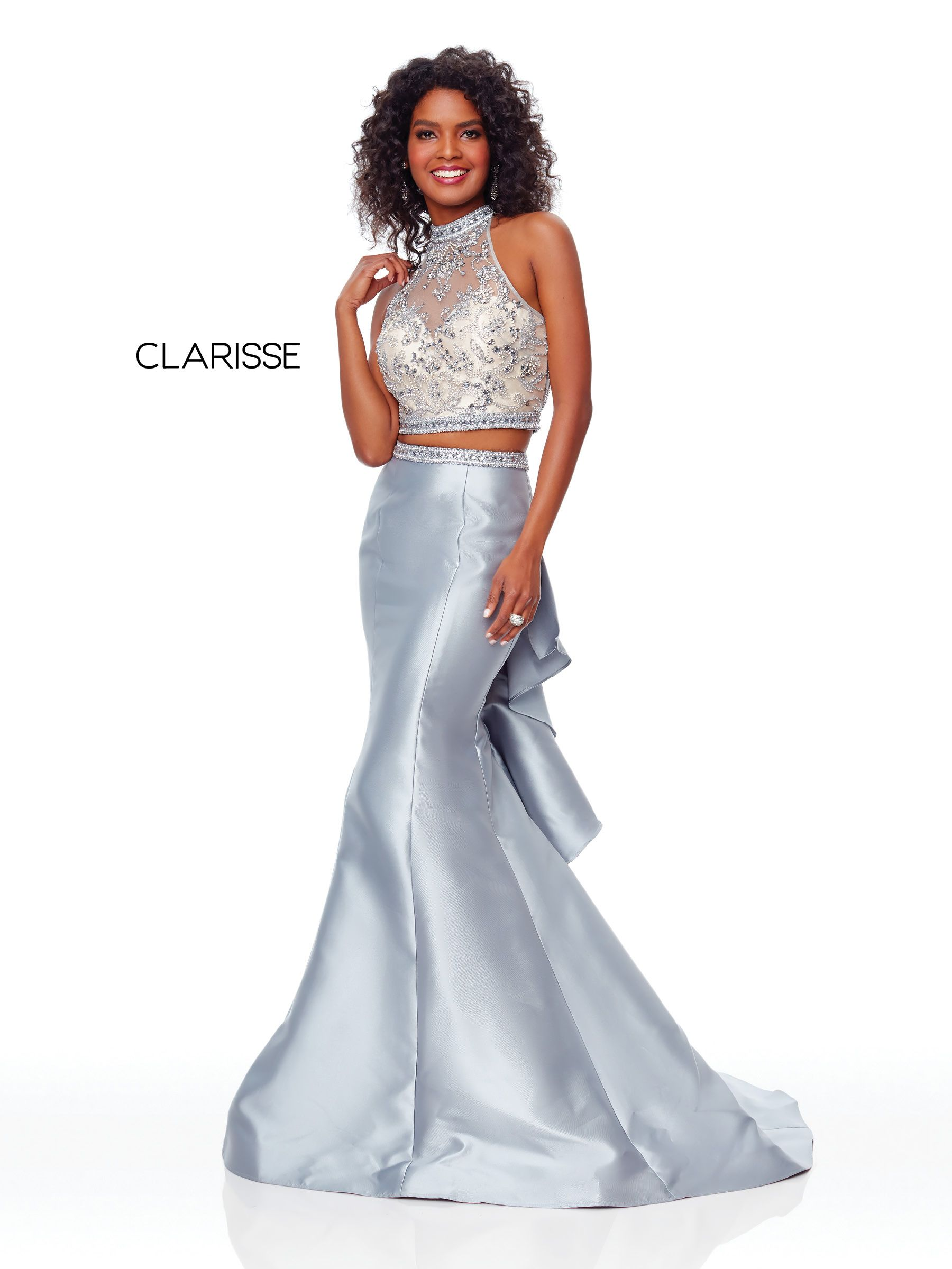 bcef55edd8aa 5055 - Silver two piece prom dress with a beaded top and a fit to flare  mikado bottom with ruffles on the back