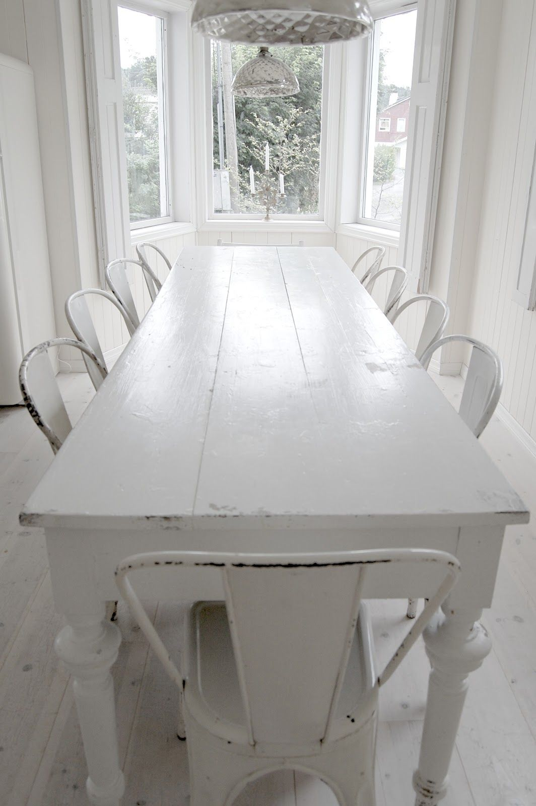 Long White Table With Vintage White Tolix Chairs.