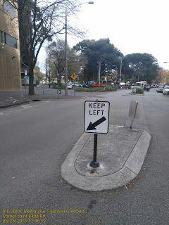 Keep left road sign at Bowen crescent   .Bowen-Crescent Melbourne Road-Signs Transportation