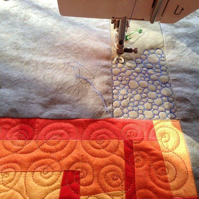 Adding texture with pebbles and spirals to my newest piece. #cindygrisdela #artquilt #freemotion #newwork