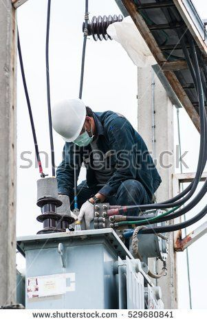 Engineer Electrician Maintenance Working On High Voltage Pole On White  Background