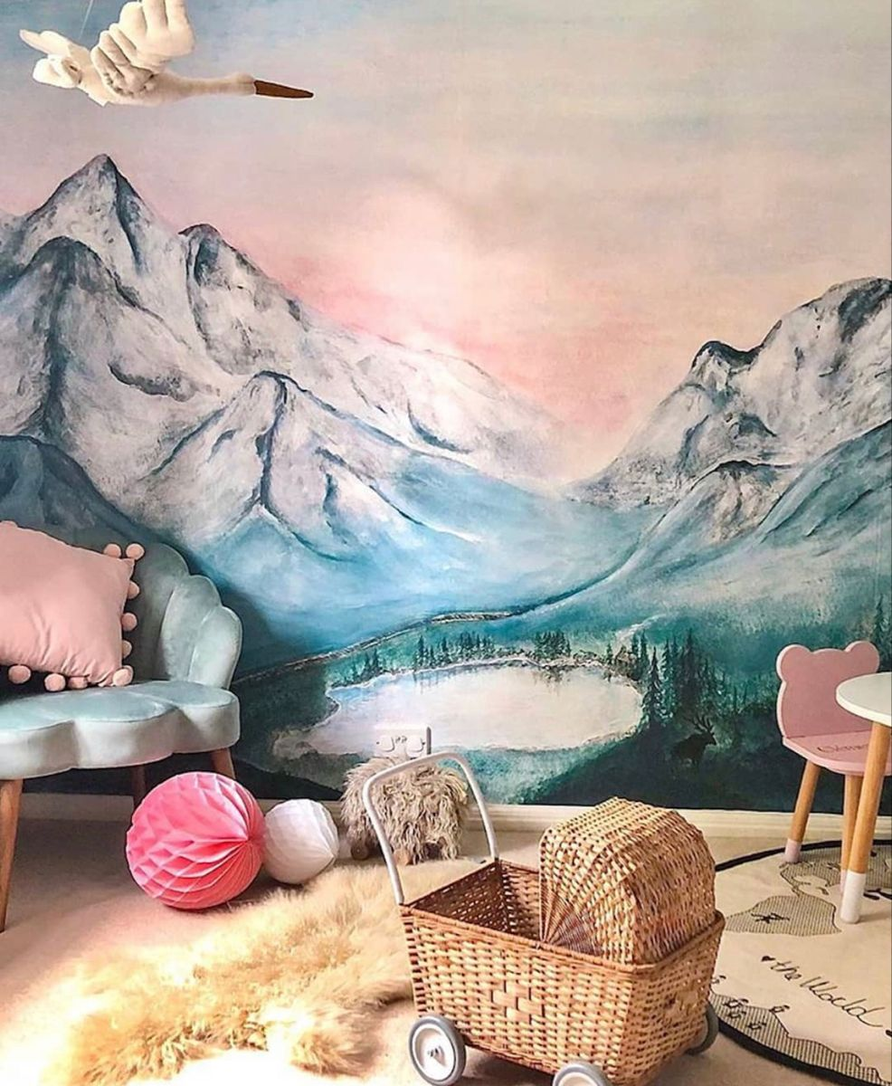 Beautiful mountain wallpaper with a retro twist. Love this nature themed wallpaper alongside the large mural wall decor. this nature mountain wallpaper is the most gorgeous accent wall in this boho kids bedroom. moutain wallpaper, floral wallpaper, nature wallpaper, Kids room wallpaper ideas, boho bedroom, boho nuesery. #mountainart #kidsbedroomideas #bohobedroomideas #playroomideas