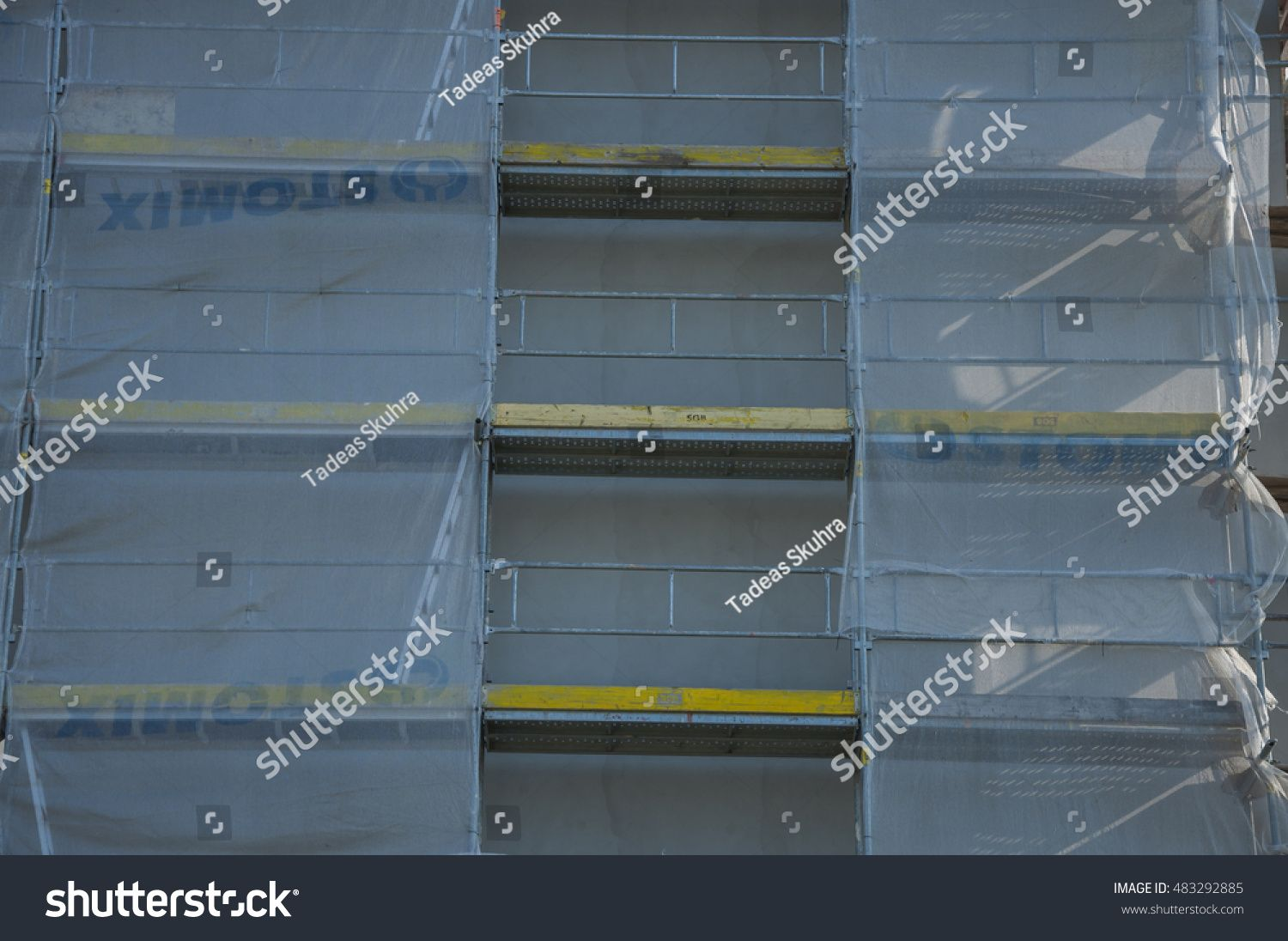 PRAGUE, THE CZECH REPUBLIC, 07.09.2016: Renovating of big house in Prague. Scaffolding on building during insulation #Ad , #Aff, #Renovating#PRAGUE#CZECH#REPUBLIC