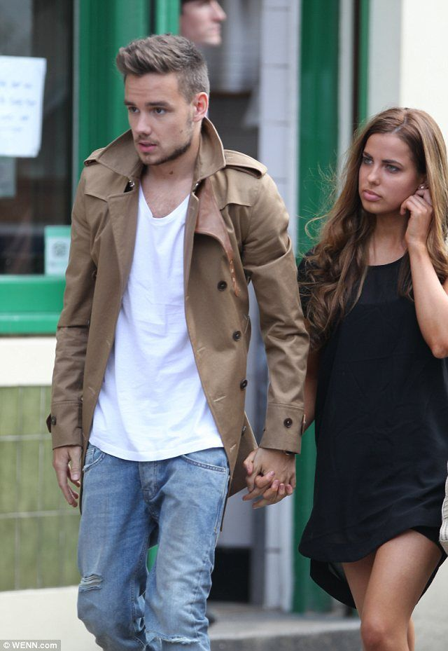Liam Payne in mid length tan trench coat