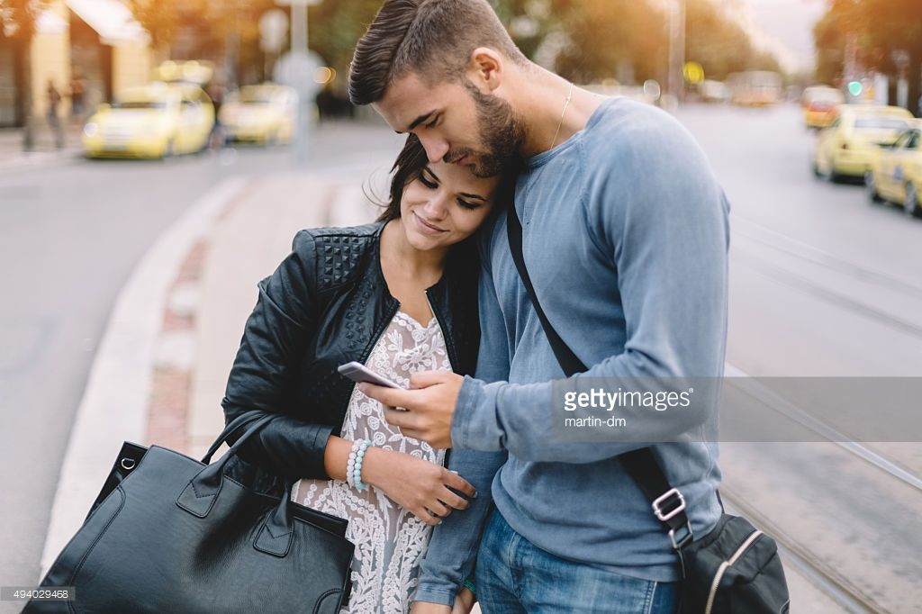 Stock Photo : Couple in the city text messaging