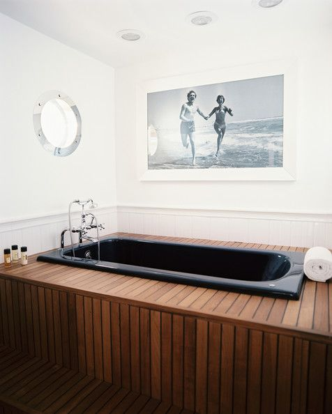 A black-and-white photo hung in a nautical-themed bathroom | Find more black and white photography at Saatchi Art: http://www.saatchiart.com/photography/black---white