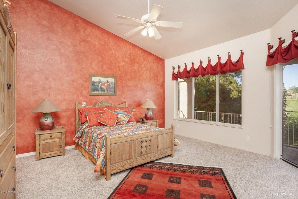 Southwestern Master Bedroom with Carpet, interior wallpaper, High ceiling, Ceiling fan, flush light
