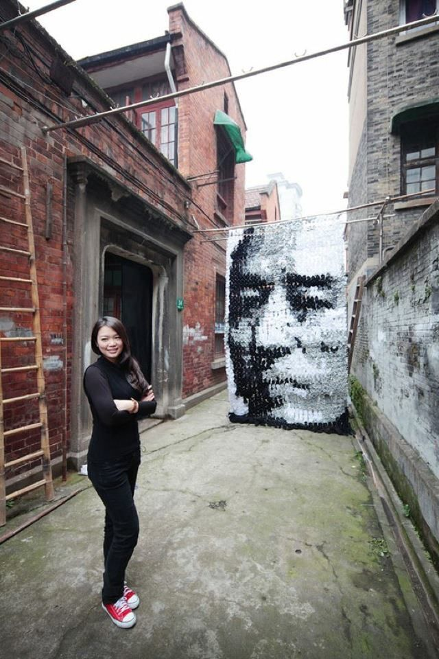 Red Hong: Made this cool portrait using 750 pairs of socks, held together by pins and bamboo sticks.