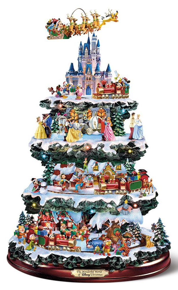 The Disney Christmas Carousel Tree This Tabletop Christmas Tree Shows More Than 50 Beloved Dis Disney Christmas Tree Tabletop Christmas Tree Disney Christmas