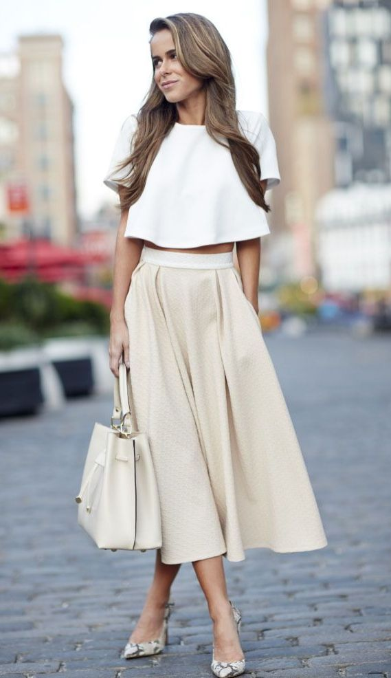 c5041aa5daa Pair a short-sleeved crop top with a flowy skirt for a little added flair.  Just add a neutral tote and a pair of snakeskin heels.