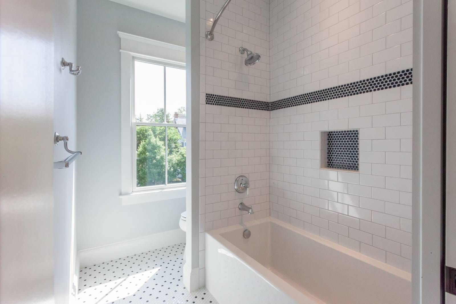 Boy S Bathroom With White Subway Tile And Navy Blue Penny Tile Shower Stripe And Niche In Cus Penny Tiles Bathroom White Tile Shower White Subway Tile Bathroom