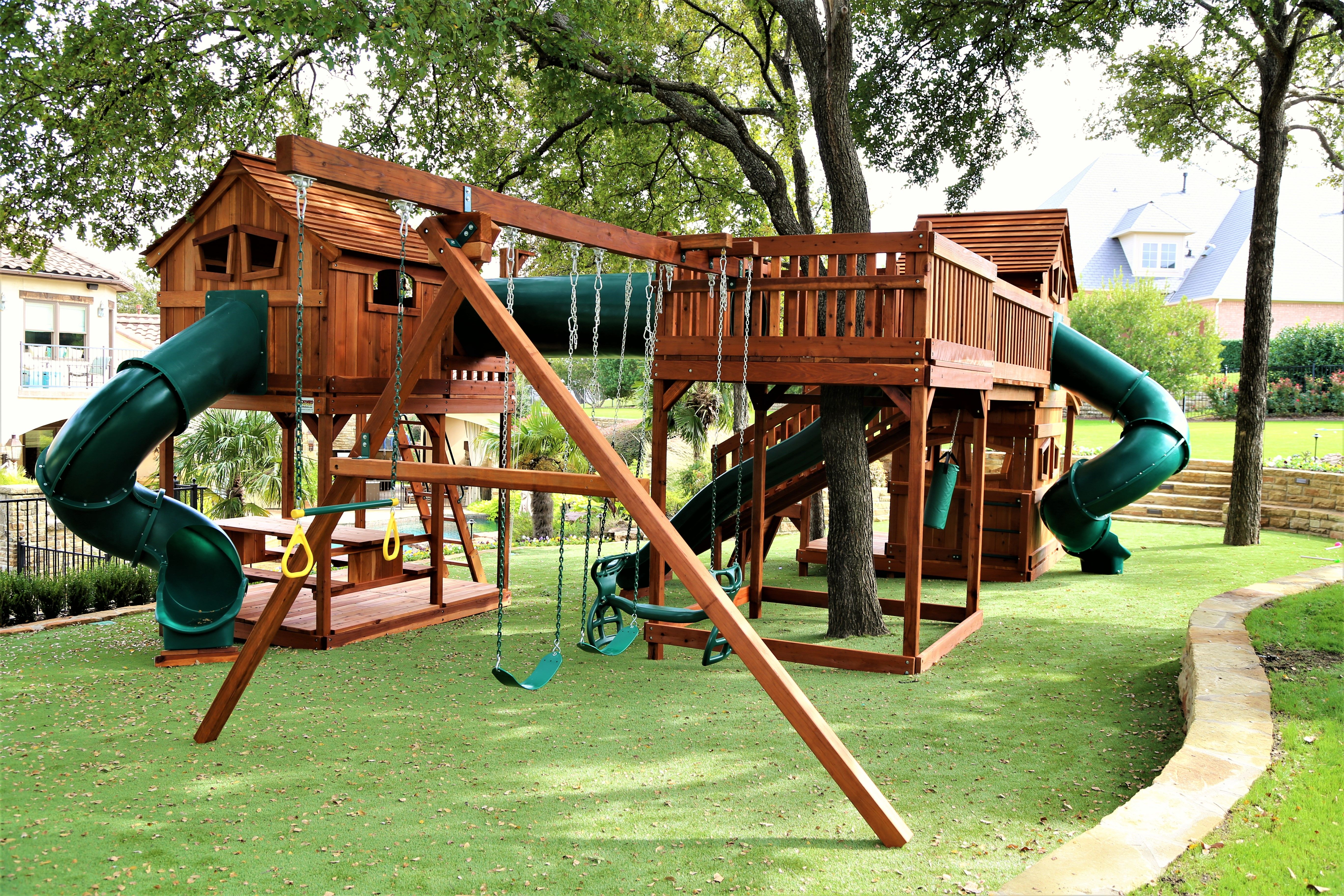 redwood custom play set shown w 5 slides crawl tube and 2 fort