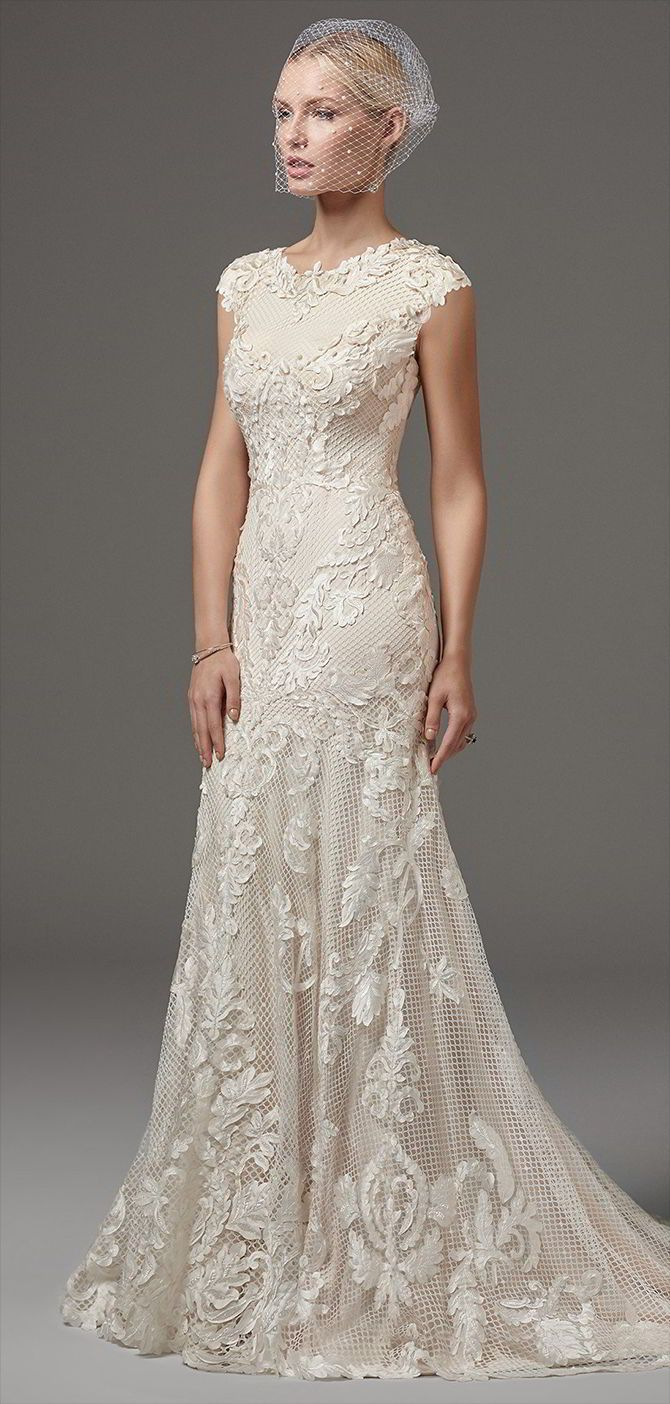 Cut out lace wedding dress  This unique and glamorous fitandflare features lasercut lace over