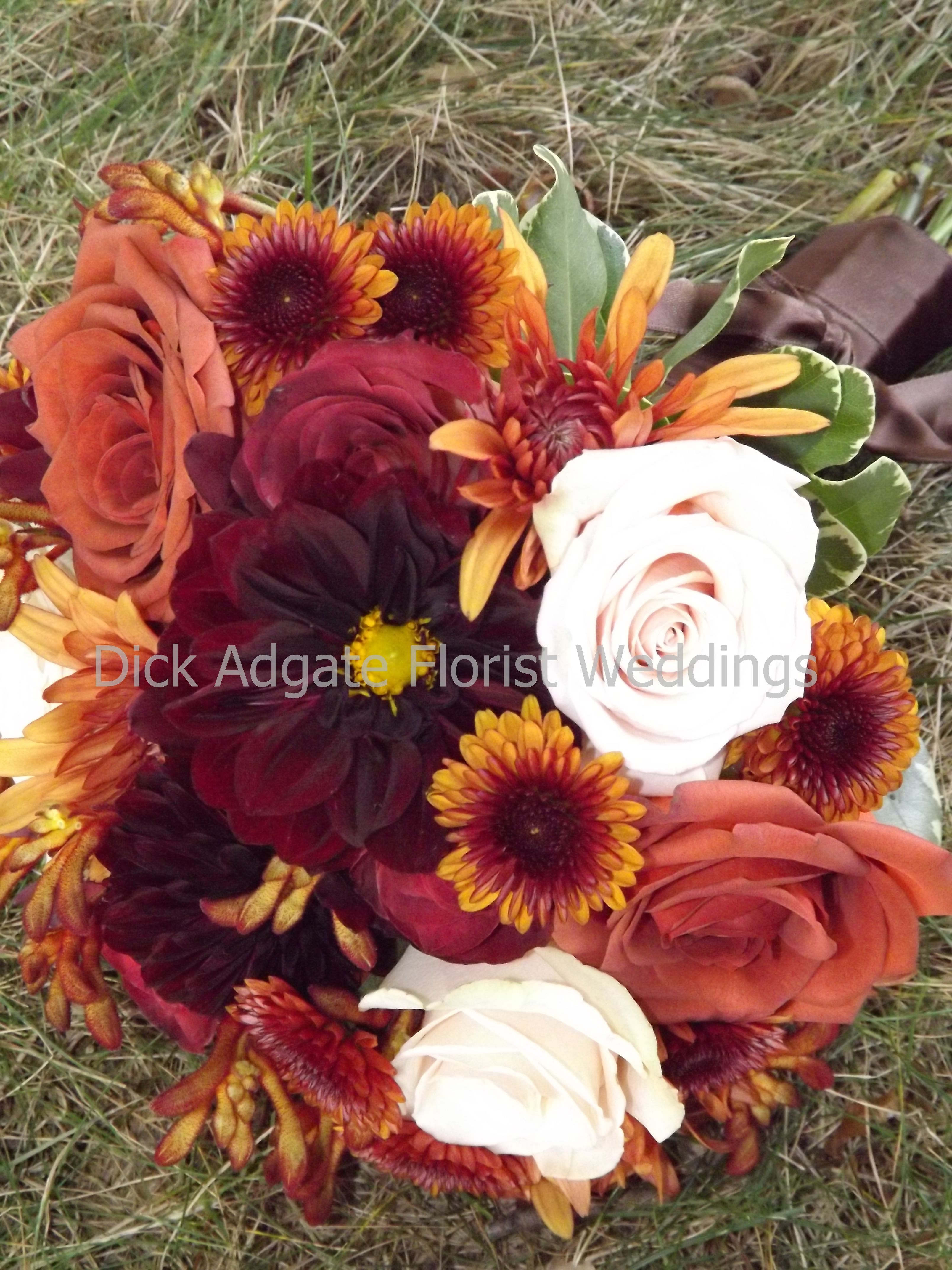 Hand tied bouquet for the bridesmaids of rust colored roses ...