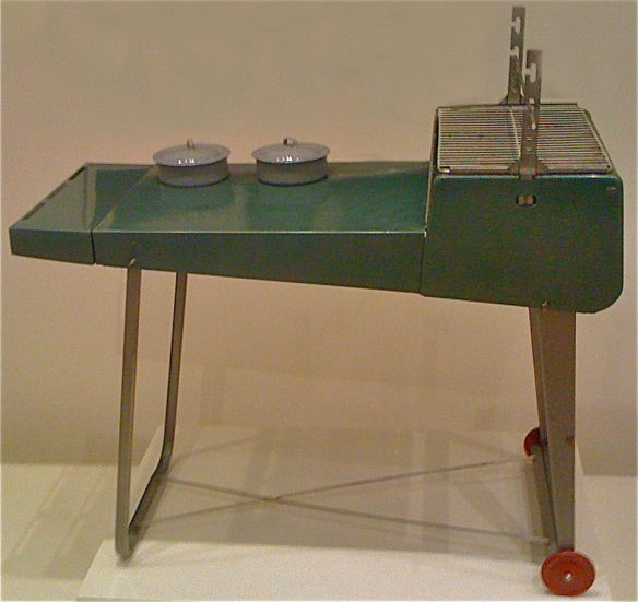 "The portable ""Lawn Chef"" designed by Raymond Loewy. It's a foldable grill from the early 1950s."