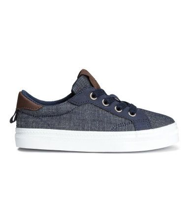 Dark denim blue. Sneakers in denim with imitation leather details. Padded edge…