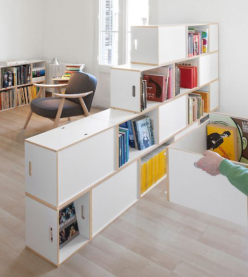 Brickbox system, separates rooms while it makes a library Available