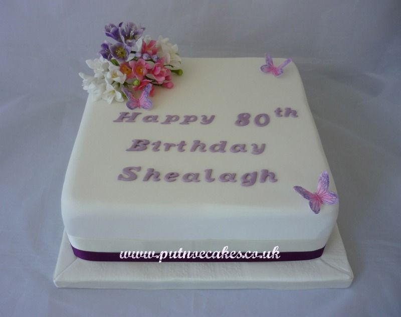 Rich fruit cake hand made freesias 80th birthday cake for a very