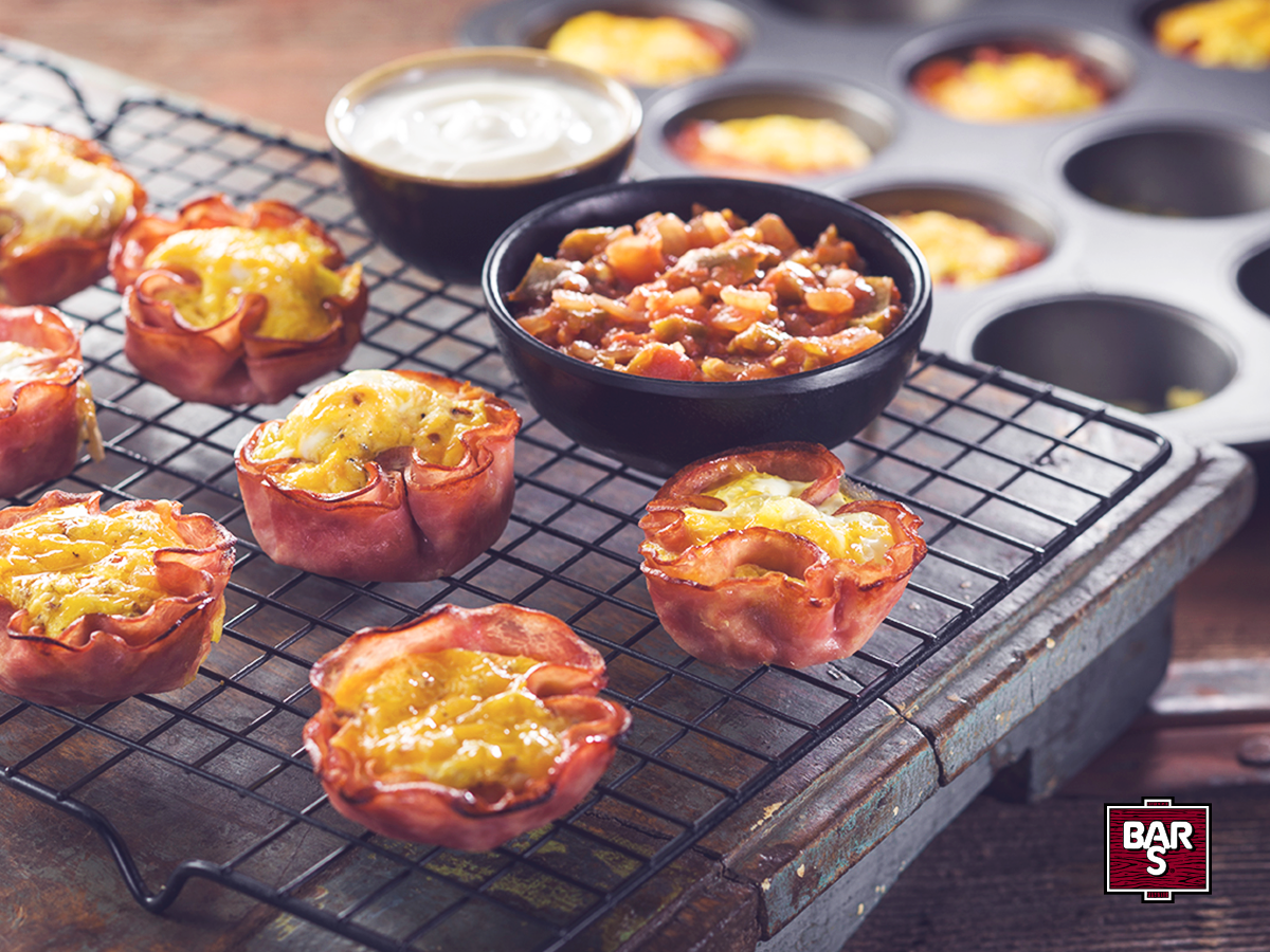 Start your day easy and cheesy with this breakfast shortcut! These delicious Ham, Egg and Cheese Breakfast Cups are easy to make.